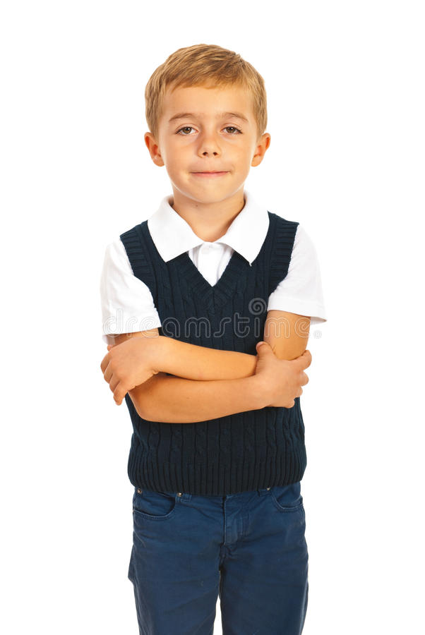 School boy with arms folded. Isolated on white background stock image