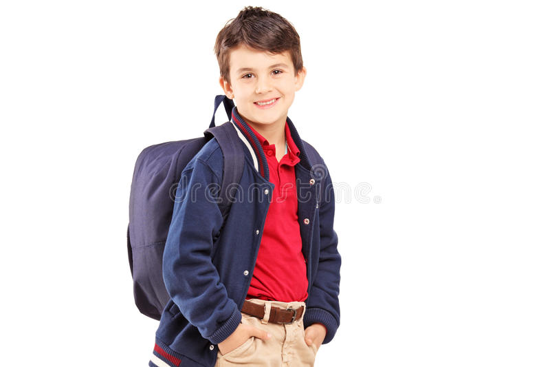 School boy with backpack standing and looking at camera. Isolated on white background stock photos