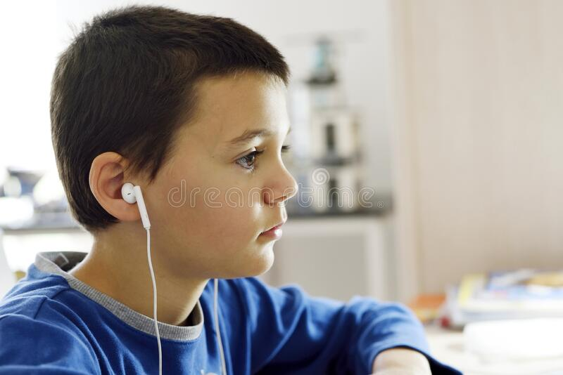 School boy on distance learning at home. royalty free stock image
