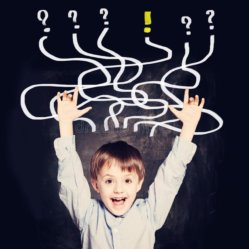 School Boy has an idea. Concept with question signs.  stock photography