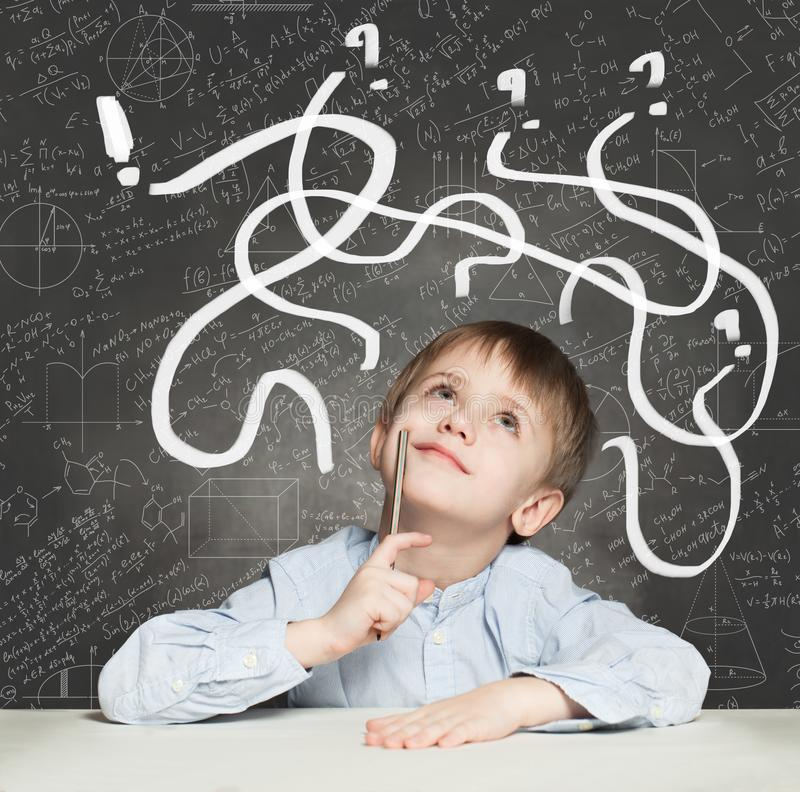 School Boy has an idea. Education Concept with question signs.  royalty free stock image