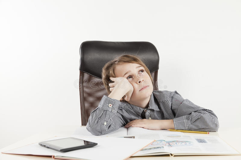 School boy hate learning. On white backgroung royalty free stock photo
