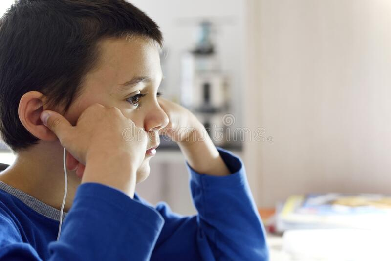 School boy on distance learning at home. royalty free stock photo