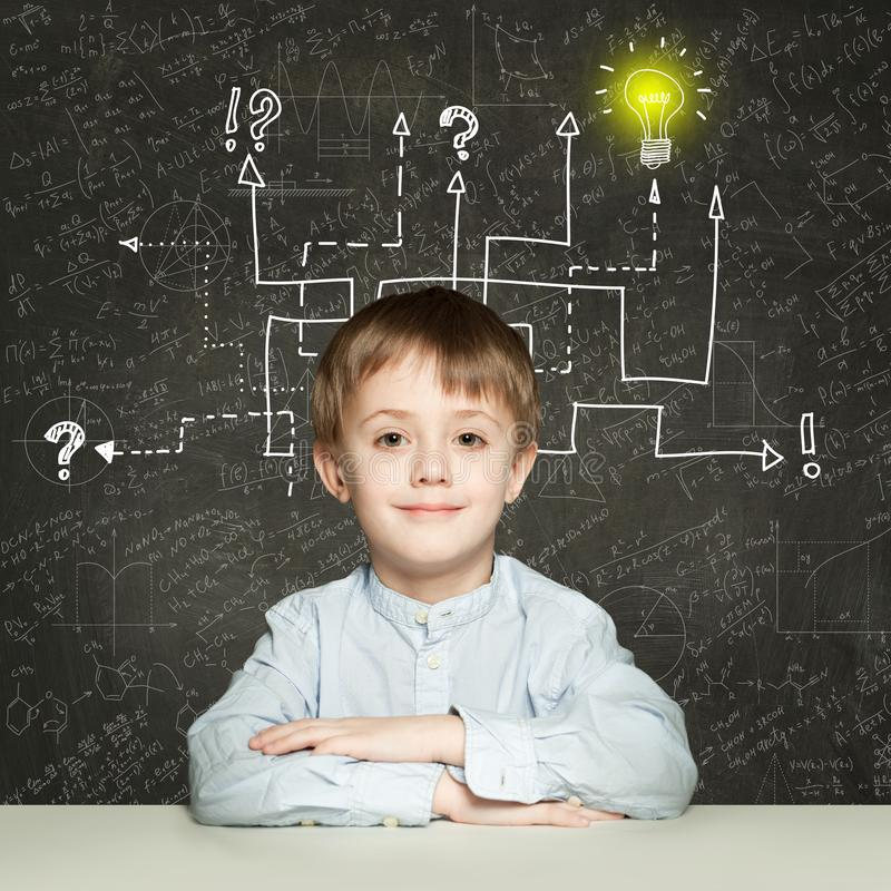 School boy with question signs and light idea bulb, education concept.  royalty free stock images