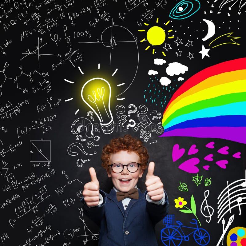 School boy in uniform on blackboard background with science formulas and art pattern stock photo
