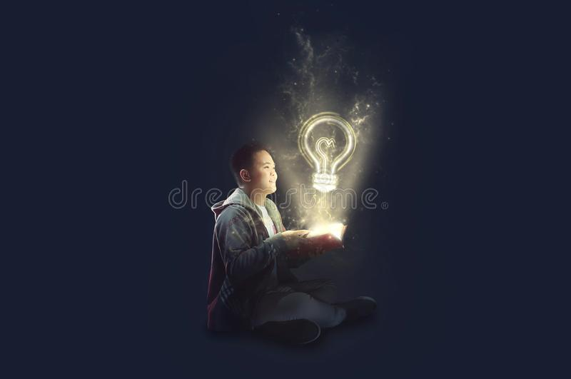 A school boy wearing a jacket holding and reading a magical book with mystical light coming out. Ideas from reading. Depicting edu vector illustration