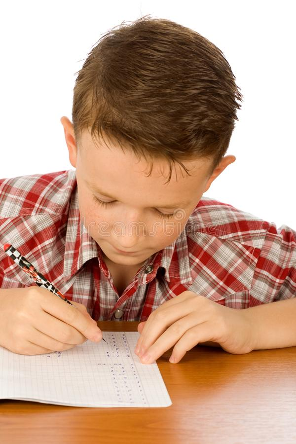 School boy writing royalty free stock images