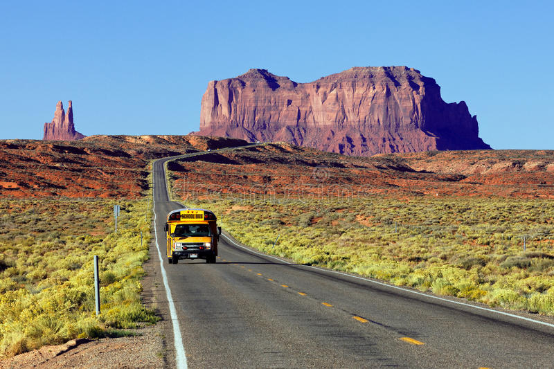 School bus. On the road at Monument Valley, USA stock photography