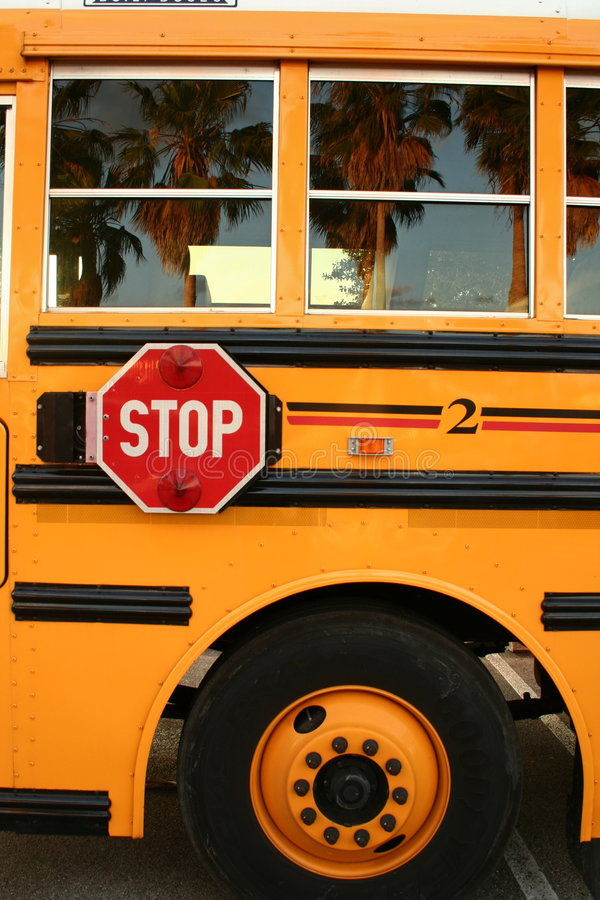 School Bus. Side of school bus with stop sign royalty free stock photos