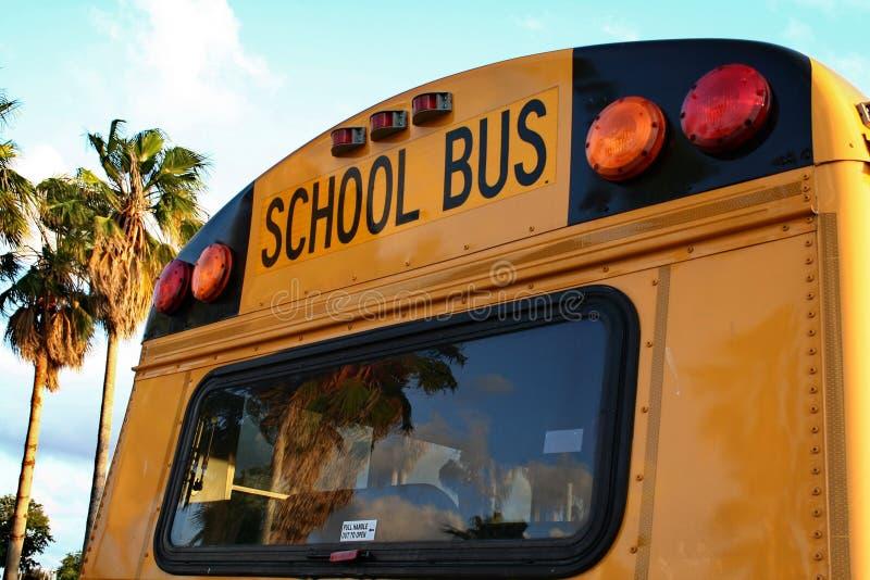 School Bus. Rear of school bus with warning lights stock photo