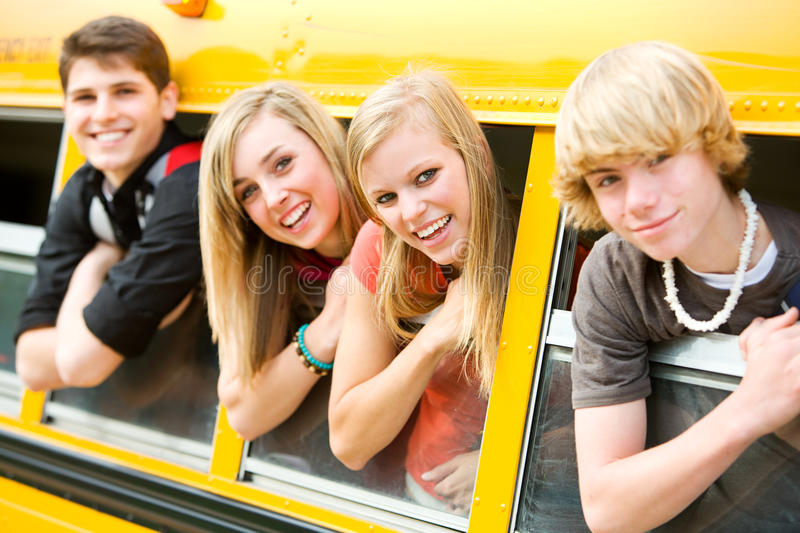 School Bus: Cool Kids Leaning Out of Bus Window royalty free stock photos