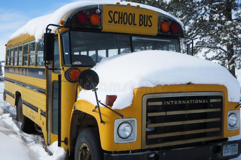 School bus covered in snow stock image