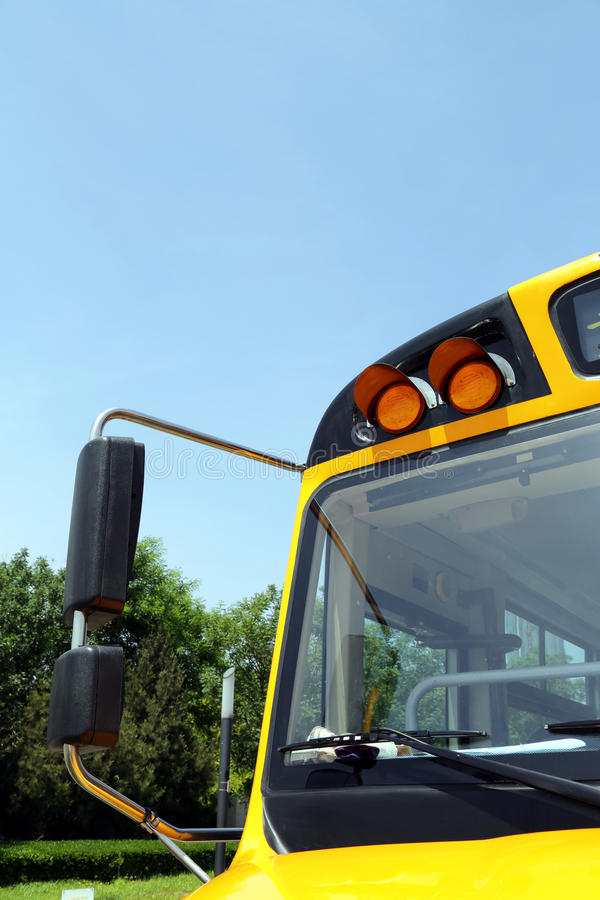 School bus detail. Yellow school bus detail with the blue sky stock photography
