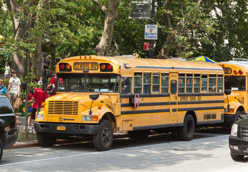 School bus in Manhattan, NYC. NEW YORK CITY, NY, USA - JULY 07, 2015: School bus in Manhattan. NYC has the largest school transportation department in the stock photos