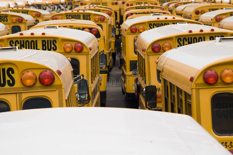 School Bus Parking. Yellow school bus in line parking with lights and mirrors - shot in Coney Island - New York 2007 stock image