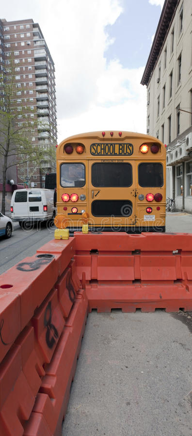 School Bus In Urban Traffic Stock Photo