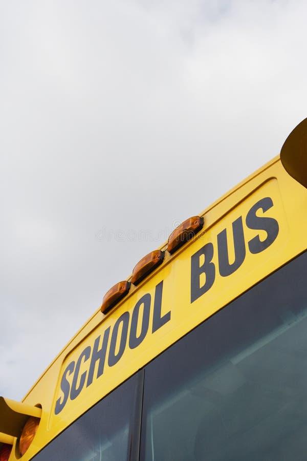 School Bus Written Above Windshield. Text written above the windshield on a school bus royalty free stock image