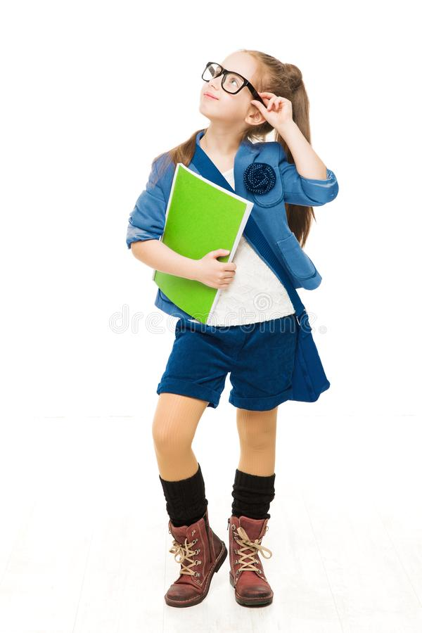 School Child, Girl in Glasses Holding Books and Looking Up. Happy Kid Isolated over White Background royalty free stock photos