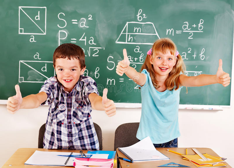 Download School Child Sitting In Classroom. Stock Photo - Image: 26671554