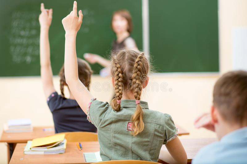 School children in classroom at lesson royalty free stock images