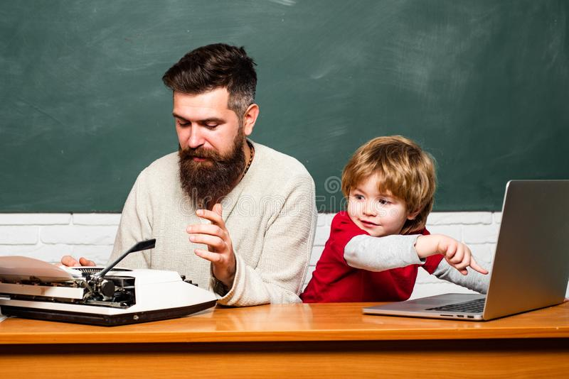School children. Father and son. Back to school and Education concept. Preschool pupil. Happy family. Chalkboard copy stock images