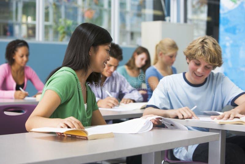 School children in high school class royalty free stock images