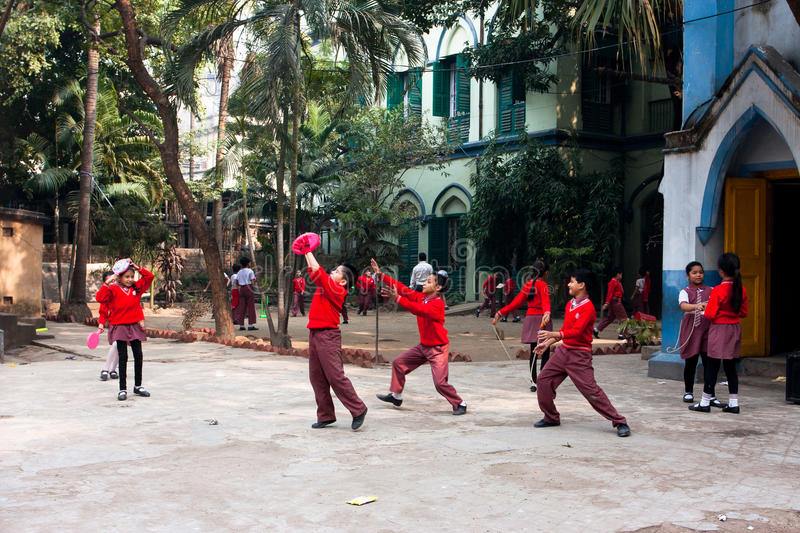 School children play frisbee outdoor. Unidentified school children play frisbee outdoor in Kolkata, West Bengal, India. West Bengal state has 18 universities & royalty free stock photography