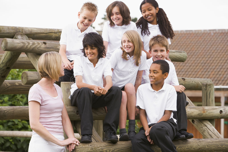 Download School Children Sitting On Benches Outside Stock Image - Image: 6080841