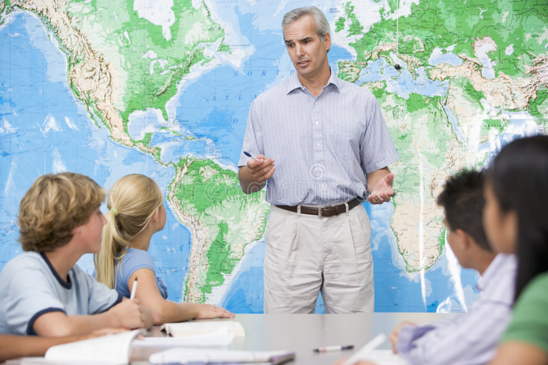 Download School Children And Their Teacher In A Class Stock Image - Image: 6082321