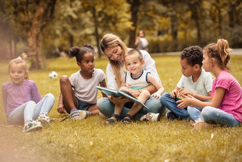 School class at nature. Teacher and children. stock photos