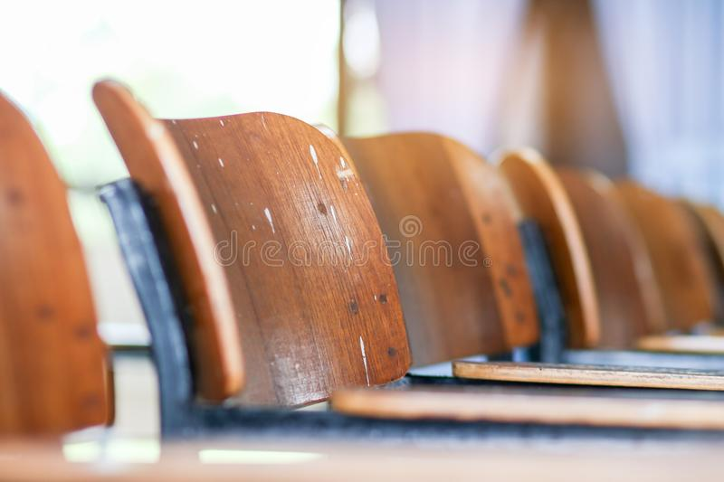 School classroom with old desks chair wood, in high school thailand, vintage tone education concept stock photography
