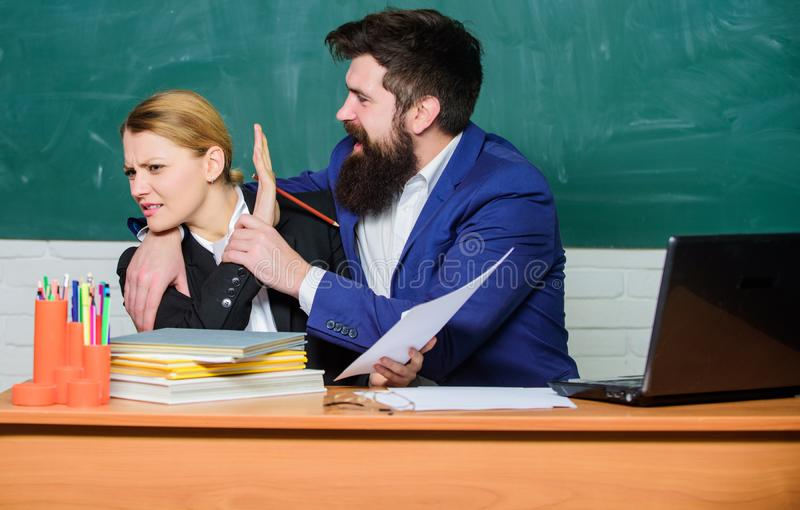 School collective and relations between colleagues. Professional differences. Teacher and supervisor working in school. Classroom. School educator and stock images
