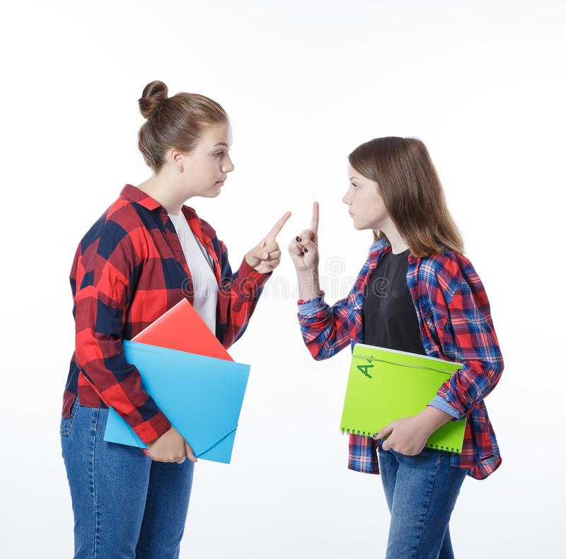 School colledge teenagers girl with stationary books notebooks. School colledge teenagers girls with stationary books notebooks warning eah other with their royalty free stock photo