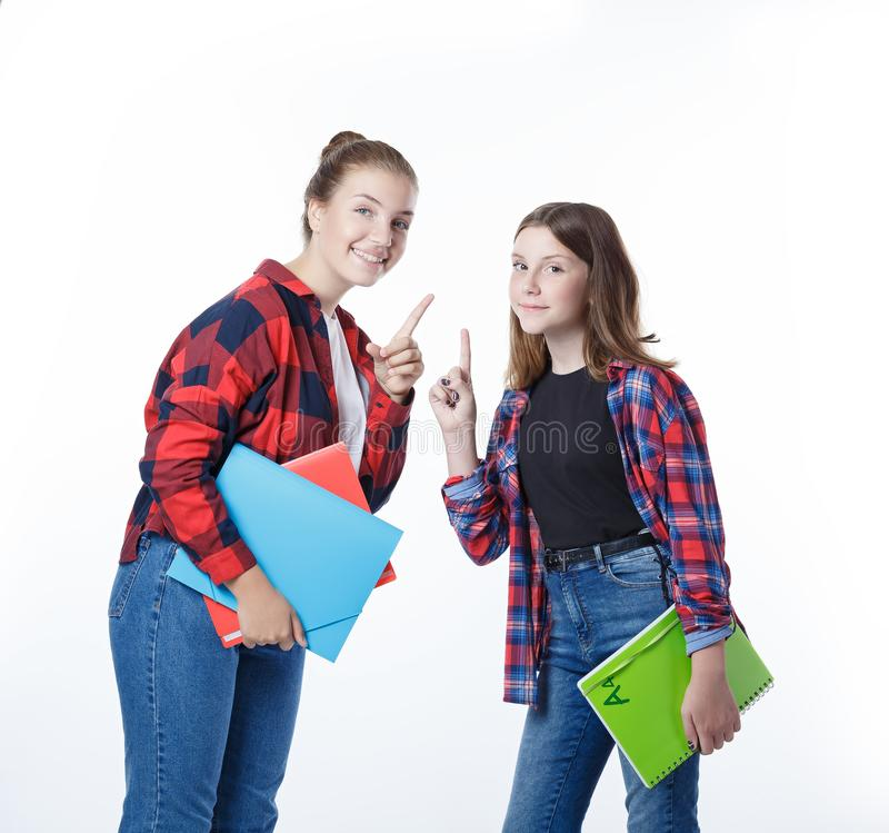 School colledge teenagers girl with stationary books notebooks. School colledge teenagers girls with stationary books notebooks warning with smile teaching royalty free stock photography