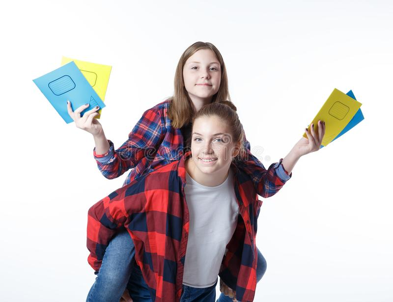 School colledge teenagers girl with stationary books notebooks. School colledge teenagers girls with stationary books notebooks having fun , the girl is sitting royalty free stock images