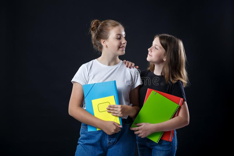 School colledge teenagers girl with stationary books notebooks. School colledge teenagers girls with stationary books notebooks are stretching out the books and royalty free stock photos