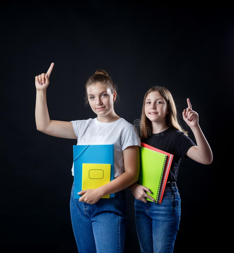 School colledge teenagers girl with stationary books notebooks. School colledge teenagers girls with stationary books notebooks have an idea concept showing royalty free stock photo