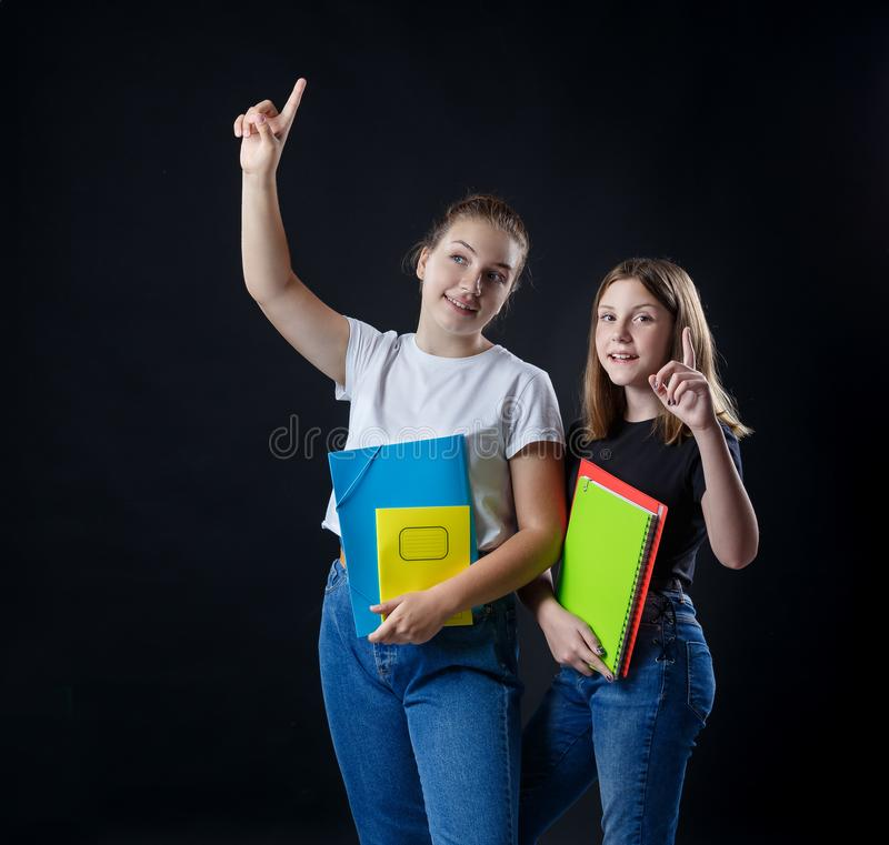 School colledge teenagers girl with stationary books notebooks. School colledge teenagers girls with stationary books notebooks have an idea concept showing royalty free stock photography