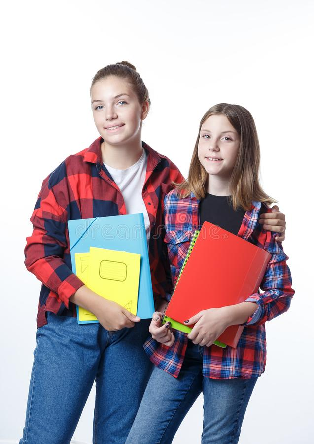 School colledge teenagers girl with stationary books notebooks. School colledge teenagers girls with stationary books notebooks are stretching out the books and stock images