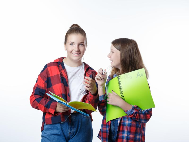 School colledge teenagers girl with stationary books notebooks. School colledge teenagers girls with stationary books notebooks are stretching out the books and royalty free stock photo