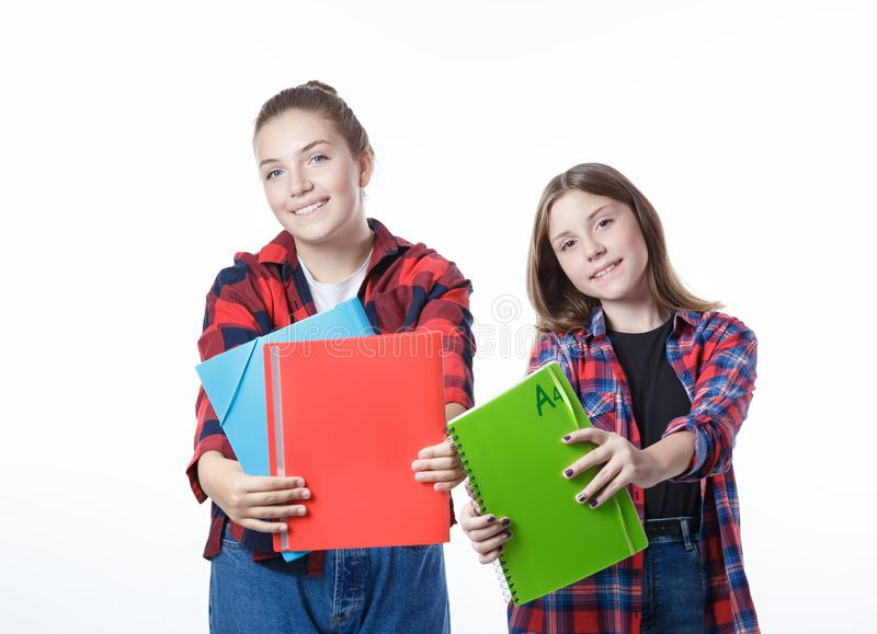 School colledge teenagers girl with stationary books notebooks. School colledge teenagers girls with stationary books notebooks are stretching out the books and stock photography