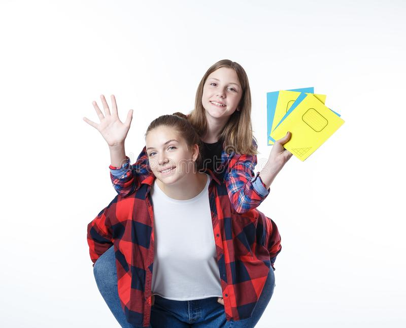 School colledge teenagers girl with stationary books notebooks. School colledge teenagers girls with stationary books notebooks are stretching out the books and stock photos