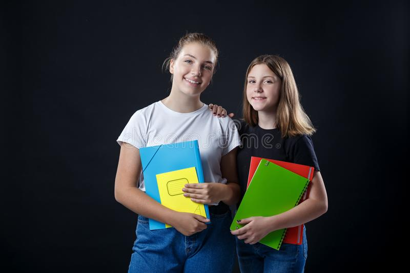 School colledge teenagers girl with stationary books notebooks. School colledge teenagers girls with stationary books notebooks are stretching out the books and stock photo