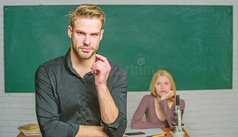 School and college education. Successfully graduated. Youth mentoring. Man well groomed attractive teacher in front of. Classroom. Obsessed with knowledge royalty free stock photo