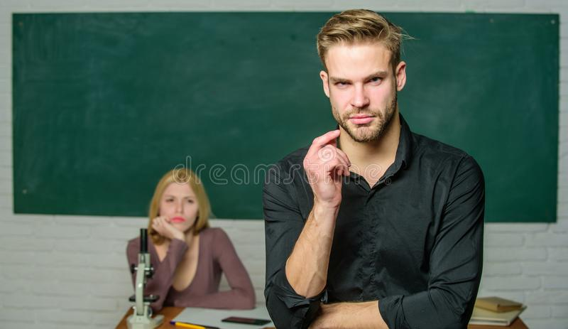 School and college education. Successfully graduated. Youth mentoring. Man well groomed attractive teacher in front of. Classroom. Obsessed with knowledge stock photos