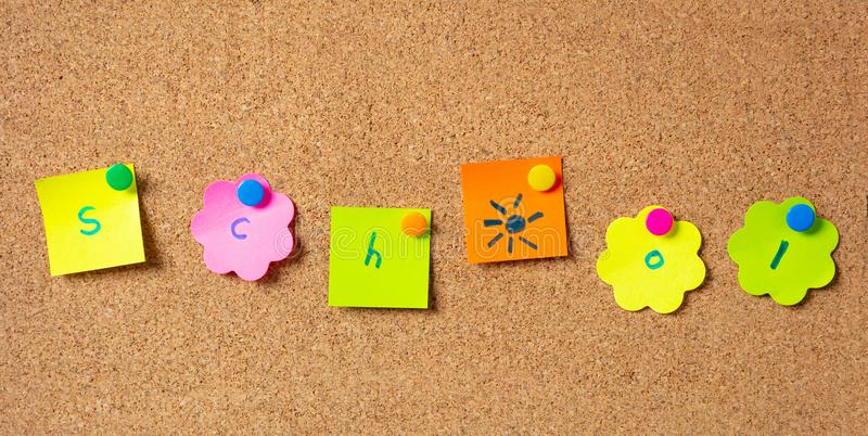 Sticky notes with letters with pushpins, colorful in various shapes and blank space, isolated on cork background. stock photography
