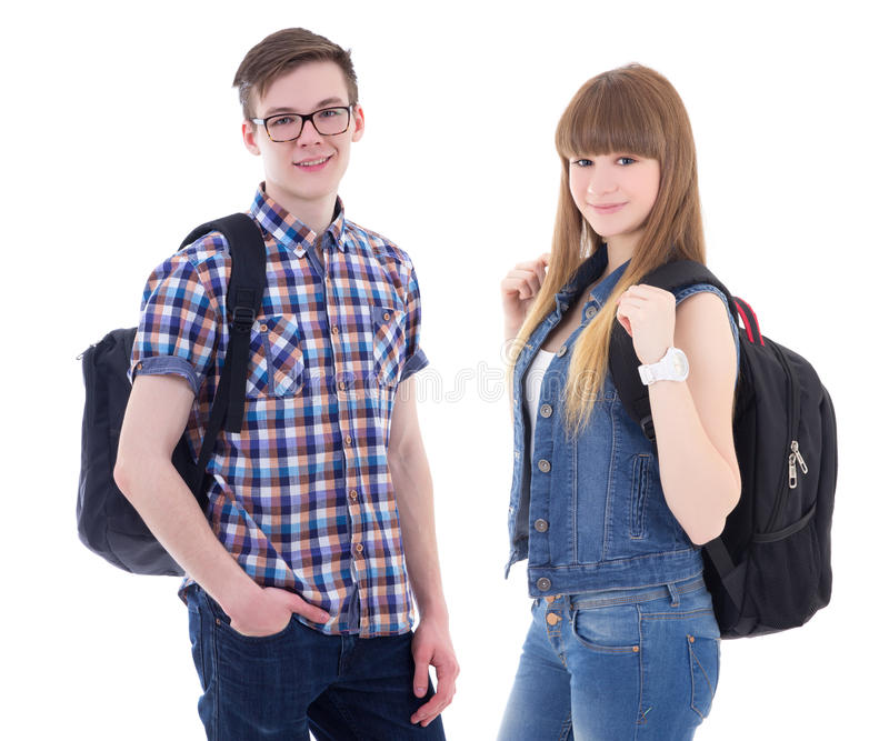 School concept - handsome teenage boy and beautiful girl with ba stock photo