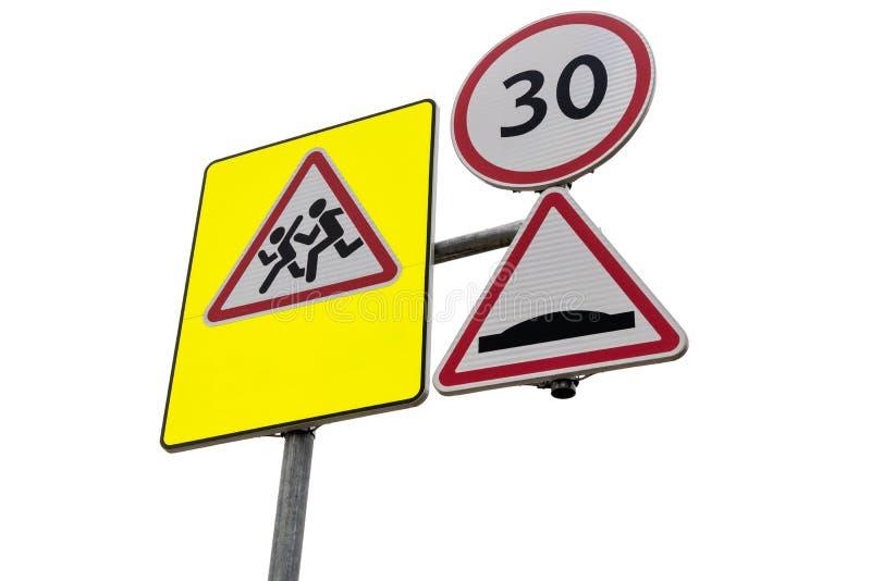 School crossing roadside warning signs. School crossing roadside warning and speed limit signs. Isolated on white stock photography