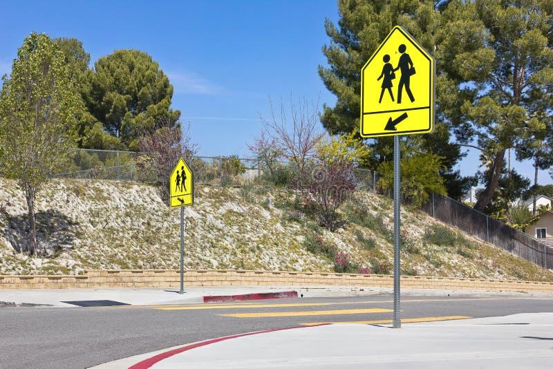 School Crosswalk Signs. School crossing signs in a residential community royalty free stock photo