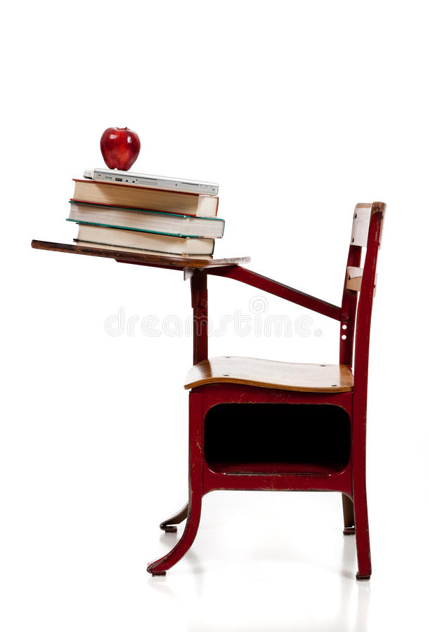 A School Desk With Books, Computer And Apple Stock Images